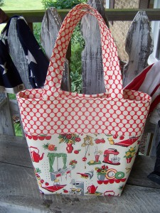Same design but the farmers market totes have less structure to them.  Love this print!