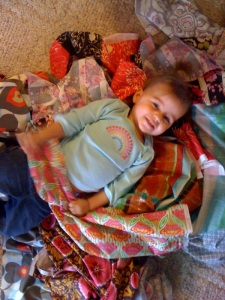 Loves fabric just like Momma...